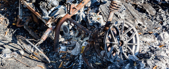 Burned damaged ruins of destroyed car metallic