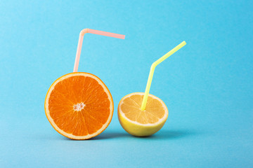 Orange, lemon with straw