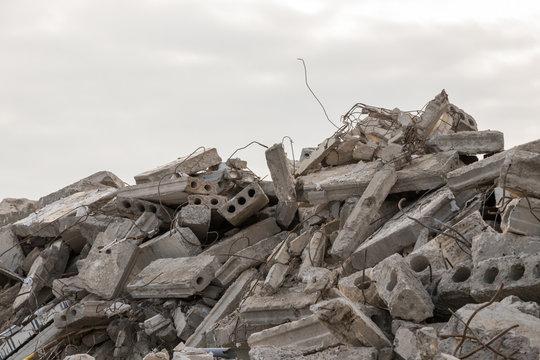 destroyed building - concrete and metal debris of a destroyed building - destroyed building