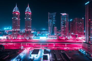 Beautiful view to Dubai and Sheikh Zayed Rd, United Arab Emirates. City skyline. Long exposure effect at night. Duotone retro wave neon noir lights color toned Fotomurales