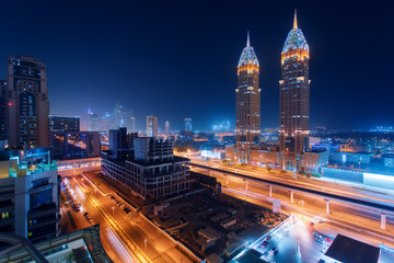 Beautiful view to Dubai and Sheikh Zayed Rd, United Arab Emirates. City skyline. Long exposure time lapse effect at night