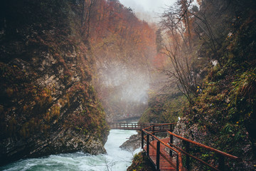 Vintgar gorge and wooden path in autumn rainy day. Bled, Slovenia
