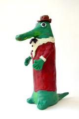 Plasticine figure Gena's Crocodile on a white background. Children's creativity