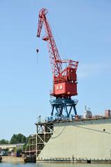 The port crane on ship dock in port. City Svetlyj, Kaliningrad region