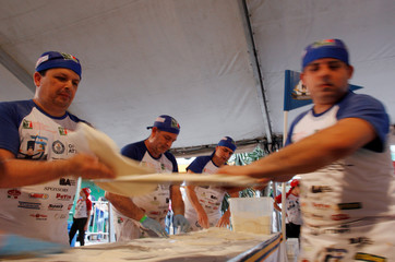 Argentine chefs cook up thousands of pizzas in an attempt to enter the Guinness World Records, in Buenos Aires