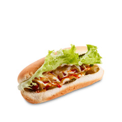 Hot dog with lettuce, ketchup and musturd