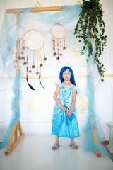 little girl in a blue wig