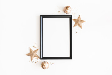 Christmas composition. Photo frame, golden decorations on white background. Christmas, winter, new year concept. Flat lay, top view, copy space