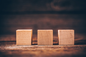 Wooden Cubes on Wood Background