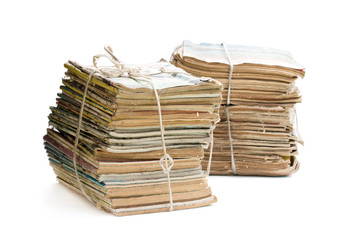 Stacks of old and dusty magazines isolated on white