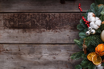 Christmas wooden background with fir tree and decoration. View with copy space