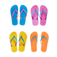 Set Of Yellow Orange Pink Blue flip flops isolated on white background. Top view