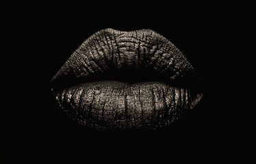 Seductive female full lips on black background. Fashionable and luxury lip professional make up. Dark side of human behavior. Young girl's lips. Wall mural