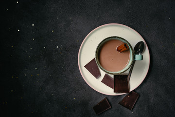 Top view of hot chocolate on dark background
