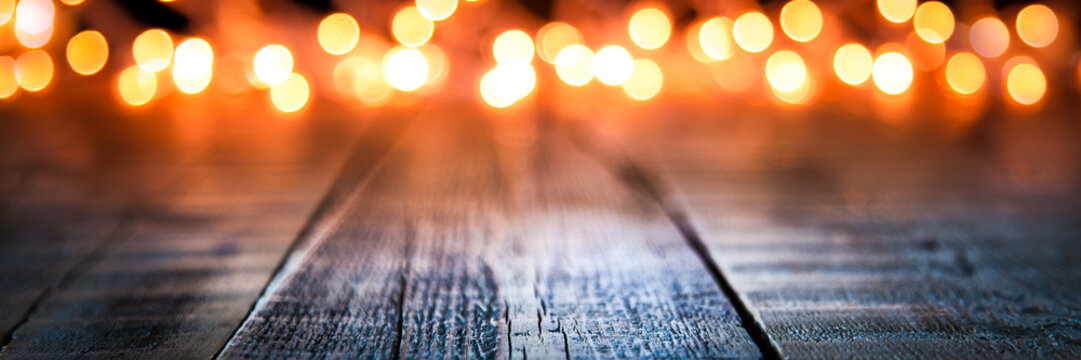 Bokeh Of Christmas Lights On Vintage Wooden Plank Table