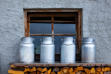 Milk Cans on a Farm in Austria in the Mountains