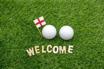 Welcome golfer with England Flag with golf ball on green grass