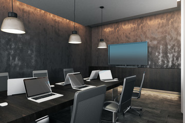 Dark meeting room with device screens