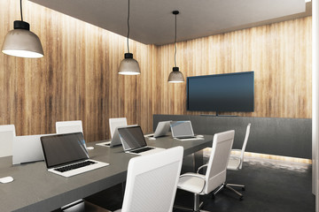 Wooden meeting room with device screens