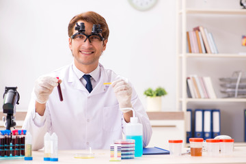 Chemist in the lab checking with ph strips