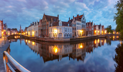 Scenic cityscape with a medieval fairytale Old town, the Spiegelrei and the Langerei canals at night in Bruges, Belgium