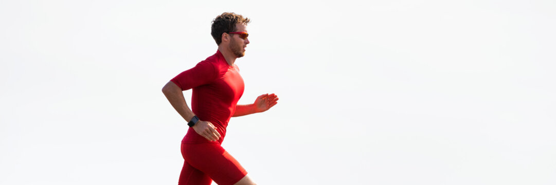 Triathlon runner man on run race marathon isolated on white background panorama banner header. Fitness and sports active male athlete jogging in sun copy space.