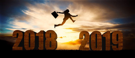 woman jump over silhouette Happy New Year 2019