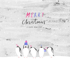 Penguins celebrate Christmas at the South Pole. Merry Christmas and Happy New Year greeting card.