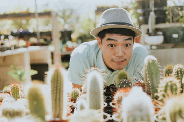 Cheerful man buying a cactus