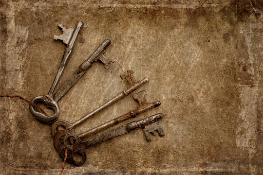 A ring of vintage skeleton keys with a textured background
