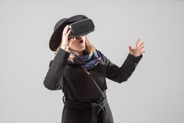 Woman uses a virtual reality glasses.  VR 360. Virtual game.