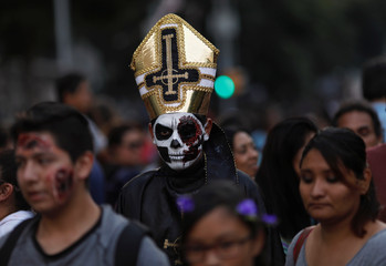 Hundreds dressed as zombies participate in an annual Zombie Walk in Mexico City