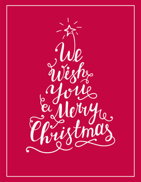 We wish you a Merry Christmas lettering text in the shape of Christmas Tree. Calligraphy white text for greeting cards or posters on red background.