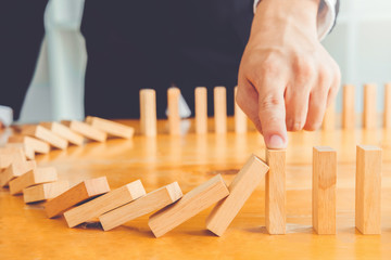 Businessman plan and strategy in business Domino Effect Problem solution