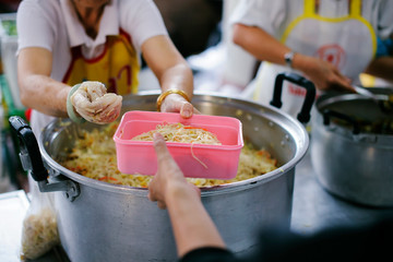Volunteers provide food for beggars: Concepts Feeding and help