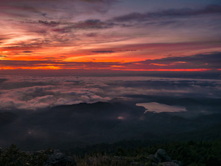 Beautiful Sunrise Sky with Sea of the mist of fog and heart shaped lake  in the morning on Khao Luang mountain in Ramkhamhaeng National Park,Sukhothai province Thailand