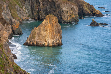 Landscape of rocky rugged cliffs on Copper Coast, Waterford, Ireland. Wild Atlantic Way coastal route