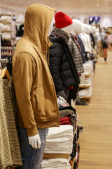 Men casual clothing shop indoor, a variety of men's clothes displayed in the shopping mall