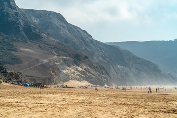Summer Ocean Beach And Mountains Landscape In Portugal