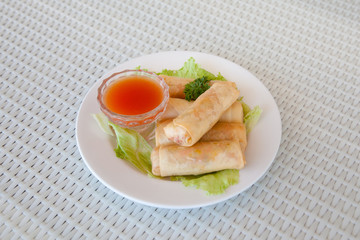 rolls with meat filling and spicy sauce on the table