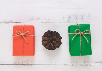 Top view of Christmas gift  ,Pine cones on wooden white background and copy space.
