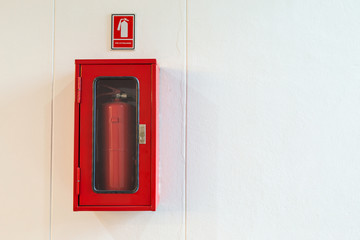 Fire extinguisher cabinet on white wall for building security
