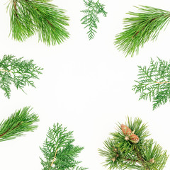 Christmas round frame made of winter tree branches on white background. Festive background. Flat lay, top view