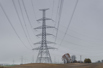 POWER ENERGETICS - Autumn landscape and energy truss tower