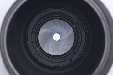 Closeup shot of closed aperture on photography lens. Taking a photo concept.