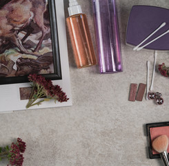 beauty products, facial products, cotton buds, earrings, sedum autumn fire flowers, orange and purple colour bottles