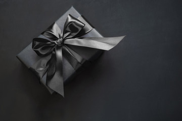Gift box in black. Top view and copy space.