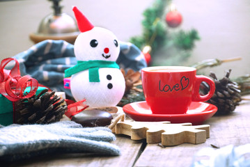 Snowman and red coffee cup decorate on christmas theme