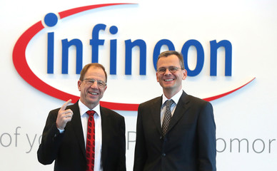 Ploss, CEO and Asam CFO of German semiconductor manufacturer Infineon poses before the company's annual news conference in Neubiberg