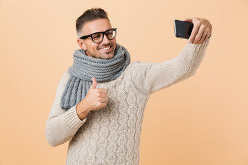 Portrait if a smiling man dressed in sweater